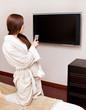 Woman watching TV in bedroom