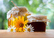 healthy honey in glass jar with flower