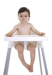 Baby sitting in highchair