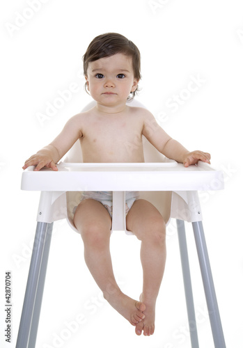 Baby sitting in highchair