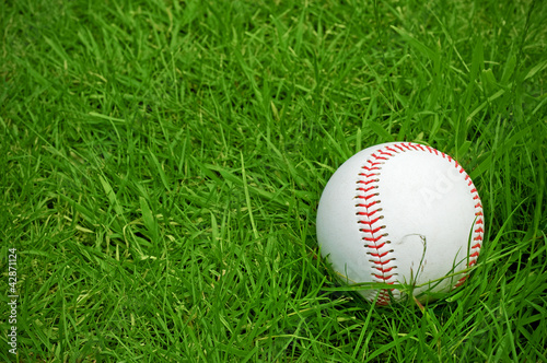 baseball on green grass pitch