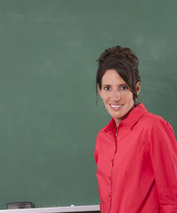 Teacher standing by chalkboard