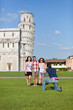 Group of Friends Taking Photo with Pisa Leaning Tower