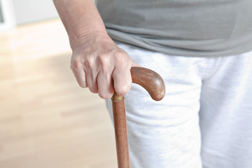Elderly Woman with Walking Stick