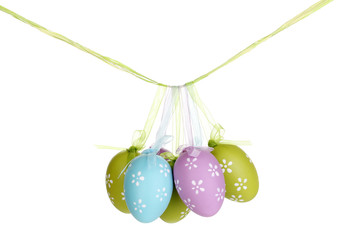 Colorful easter eggs hanging on ribbons isolated on white