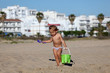 Toddler girl playing on the beach of Conil de la Frontera, Spain