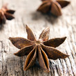 Spices anise stars on the vintage wooden surface