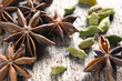 Spices anise stars and cardamom on the vintage wooden surface