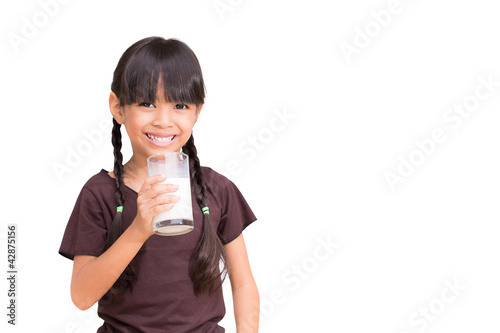 canvas print picture Smiling little girl with a glass of milk