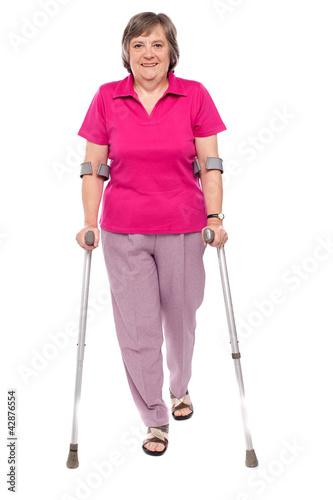 Full length portrait of an injured senior woman
