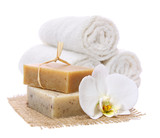 Natural, organic soap bars on burlap with white orchid