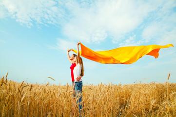 Teen girls at a wheat field