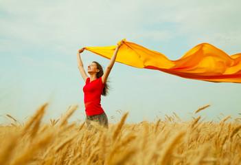 Teen girl at a wheat field
