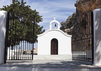 open gate to white church