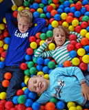 Kids playing in fun balls