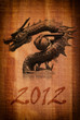 Chinese style dragon statue on the wood texture.