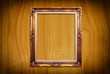 Photo frame on the wood texture.