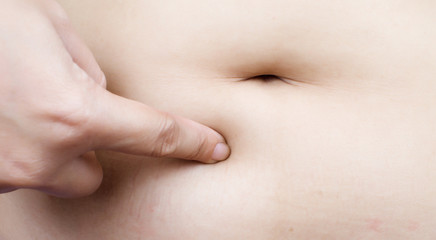 Stomach fat woman body part.
