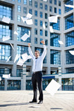 Businessman throwing paperwork