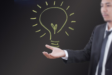 Businessman holding light bulb concept.
