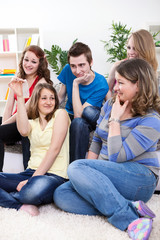 Teenagers having discussion about protection