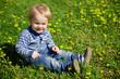 Happy little boy in flowers