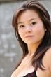 Young asian girl look at camera