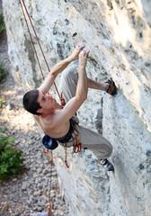Rock climber focusing on the next movement