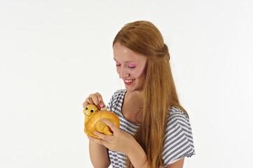 girl saving money with piggy banck