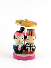 Couple of wooden Vietnamese doll with national costume isolated