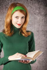 American redhead girl with book.