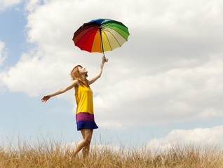 Girl with umbrella at meadow.