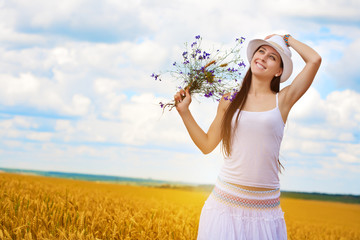 girl's portrait  with wild flowers
