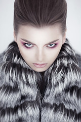 Fashion female russian model with fur collar - beauty shoot