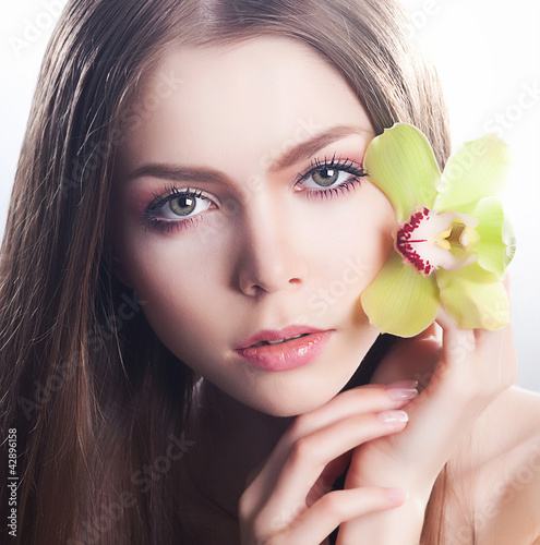 Clear healthy skin of beautiful woman face close up portrait
