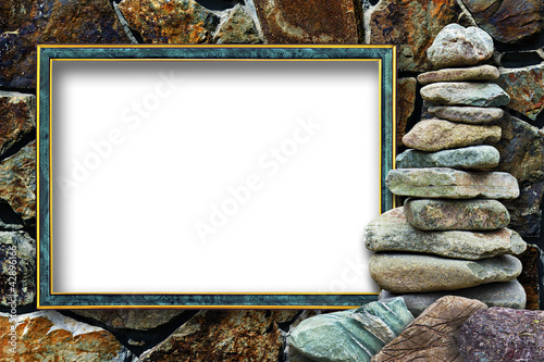 Frame for a photo with a cairn on a stone background