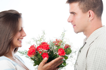 Man giving bouquet of flowers to his girlfriend