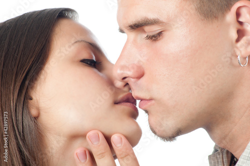 Young couple kissing isolated on white