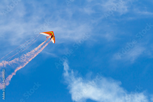 Hang glider flying through the sky