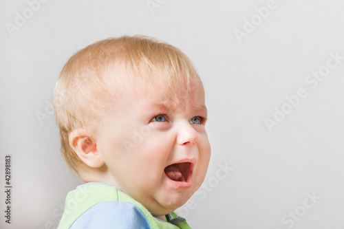 Boy looking up into space screaming