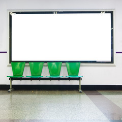 blank billboard with empty chairs