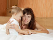 mother with her baby  on white sheet
