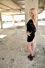 Sexy blond lady in black dress