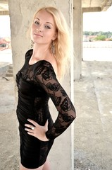 Sexy blond girl in black dress