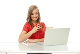 Young woman using laptop smiling