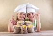 Kids with chef hats and pasta varieties - traditional food
