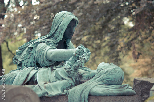 Cemetery Pere Lachaise in Paris, graves and sculptures