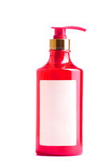 red plastic bottle of liquid soap
