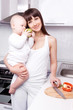 woman with baby cooking