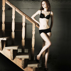 Beautiful woman on a stairs